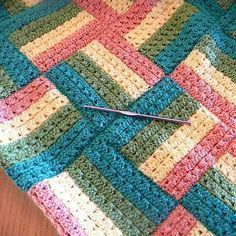 Sonoma Crochet Baby Blanket- This striped granny square baby blanket looks so unique!