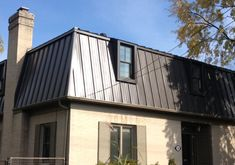 Metal Mansard by Nail It Roofing.