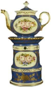 Peacock blue, with white bands and gilding around stand and teapot; white ovals on stand and teapot containing bouquets of pink roses; fluted collar. Traditional shape.  Acquired in France