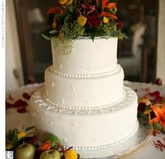 Janna and John cut a three-tier white cake with apricot and buttercream filling. It was covered with fondant and adorned with fresh flowers.