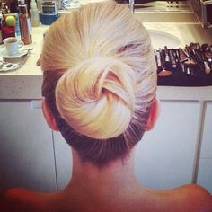 I like the colour tones in her hair. and the bun is cute too...