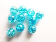 You will receive (10) gorgeous 14mm (9/16) marine crystal Turquoise cracked marbles.  The process of cracking or frying marbles creates a unique effect and makes them shimmer, sparkle and shine bright like a diamond! I have already performed this dangerous process for you, so that you dont have to. You can use these marbles to make earrings, pendants, rings by placing marble in a wire cage or you can glue a bead cap with a head pin on top of the marble. Makes great charm bracelets. Or you…