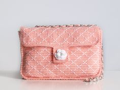 Coral crochet bag with white backstitchs. $160.00, via Etsy.