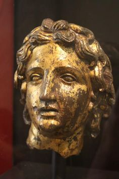 Head of Alexander the Great from a smaller than life-size statue. Goldleaf on bronze, (2nd century CE). #History