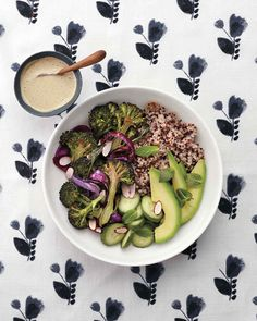 This vegan, gluten-free grain bowl is packed with flavors and textures, thanks to roasted veggies, a creamy tahini dressing, and cool, crisp toppings.