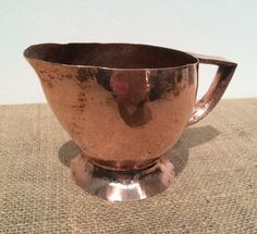 Beautiful little Copper Jug Has a hammered finish in a style of arts and crafts. Could be used but possibly best as a display item. Dimensions (approx) 17.5cm (W) x 11cm (D) x 10cm (H)