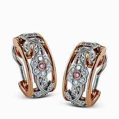 The intricate floral design of these elegant two-tone classic style earrings is accentuated by .04 ctw of round cut yellow diamonds and .23 ctw of round cut white diamonds in an arresting yellow and rose gold setting.