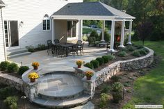 Love the circular corner...as an entry to the rest. Of the yard..rather than a confinement yo the patio
