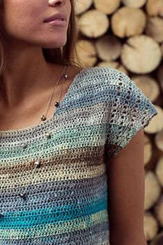This top has figure-flattering converging lines highlighted by a slow-striping yarn. Short rows create the asymmetrical rows in the body; filet crochet adds interest to the short drop sleeves.