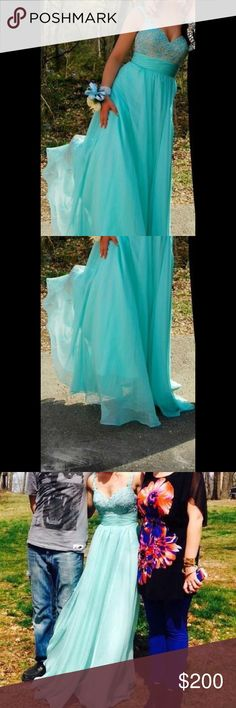 ONLY WORN ONCE. Prom dress! Beautiful baby teal prom dress only worn once to my junior prom. It says size 000 but I think would fit up to 1-2 cause I was not a 000 in other clothing! It has a beige/crime color in the bust, behind some decorative floral pattern. I paid $450 from a high-end wedding dress shop but will negotiate as fair as I can!  Dresses Prom