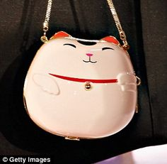 Kate Spade NY Autumn Collection: As usual, it was the kitsch accessories that stole the show; clutches came in the shape of Chinese take-away boxes and Japanese cats