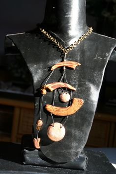 Collana etnica richiama campana a vento giapponese con gong interamente modellata a mano