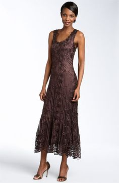 Mother of the groom dress---posting because I like the length. Not my color but like the simplicity of it.