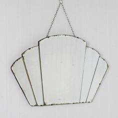 A beautiful vintage bevelled edge mirror in great condition. A beautiful vintage mirror to add effortless style to your home. Beveled Edge Mirror, Art Deco Mirror, Under The Table, Wood Blocks, Hanging Chair, Ceiling Lights, Pendant, Glass, Mirrors