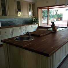 A custom kitchen counter top in Baleka kiaat - the hob cutout was made into a matching cutting board. Baleka is a technique where we laminate strips of wood into a solid panel. Magic !