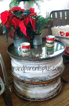 Truck tire rims stacked together.  Add a glass top to make a one-of-a-kind side table! - Christmas Idea House 2013