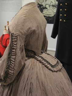 2012-08-25 KSMF - Linsey-wooley striped day dress with black braid (to imitate a bolero) (American), circa 1862.