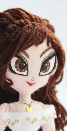 Maria Posada art doll made from felt and yarn. Click on the image to be re-directed to store