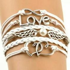 Multilayer Braided Infinity Charm Bracelet BRAND NEW! Design has LOVE, wings and hearts! Very cute - stylish and simple! Pair it with any outfit! Comes in the color white with silver tone pieces. Jewelry Bracelets