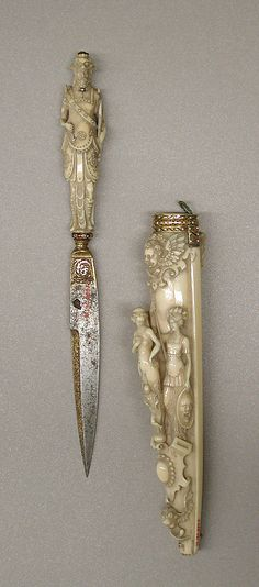 Knife and sheath. Early 19th century. French (Dieppe). Ivory, ruby, diamond, steel (gilt), and enamelled gold.