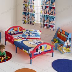 Make the move from cot to a 'big' bed easy with the Mickey Mouse Cosytime Toddler Bed. Big on imagination but easy on the pocket, this toddler bed will have your little one right on track for a brilliant bedtime routine. It features protective side panels to prevent bedtime tumbles, whilst the steel metal bed frame is sturdy, safe and snug so they get a good night's sleep and you get peace of mind. http://www.pricerighthome.com/Mickey_Mouse_Cosytime_Toddler_Bed/MIC283.html