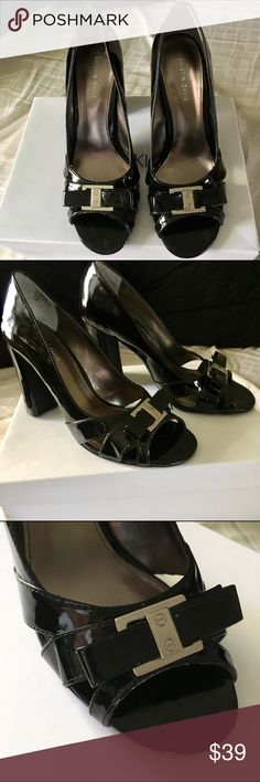 BRAND NEW ELEGANT BLACK Shoes BRAND NEW, never worn ELEGANT BLACK Shoes. Metal detail on the front. Super classy and comfortable with the trendy thicker heels. Size: 7. Reasonable offers are considered but no lowballing please. No Trades. Shoes Heels