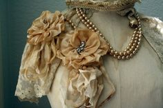 Vintage looking tatteredd ribbon rose pins.  Love It!