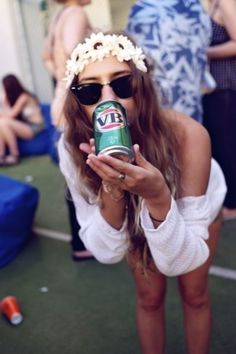 Flowers, cold drink. loose shirt & sweet shades.