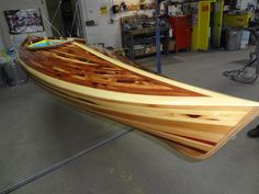 Me and my husband built this kayak.  It was built around a form using 1 inch cedar strips or various colors.  Took over a year to build.  See my board for more pics