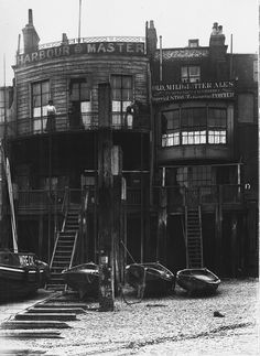 "The Bunch of Grapes, now known as The Grapes is a public house on the river Thames in Limehouse, East London, that was immortalised as The Six Jolly Fellowship Porters Tavern in Our Mutual Friend. It was ""a tavern of dropsical appearance … long settled down into a state of hale infirmity."