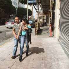 """""""Elsewhere in the city (see today's @streetvogs post), a young couple in love strolls down Los Angeles Street in the fashion district."""" @americanobscura for @streetvogs"""