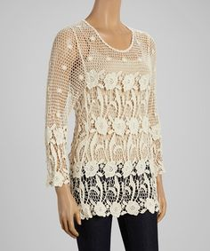 This beautiful crochet top is sheer with a lovely floral design. We have two of these little numbers. They are listed as one size fits all and going for $40 a piece.