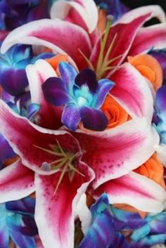 Tropical Beach Wedding Flowers- Stargazer Lilies, Blue Dendrobium Orchids, and Tropical Amazone Roses
