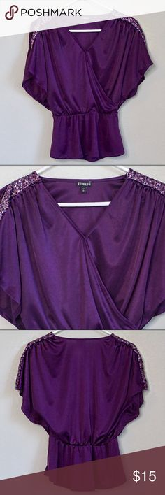 "Express Purple Sequin Blouse Express Purple Sequin Blouse  Size: Extra Small Color: Purple Condition: Pre-owned; Excellent  Material: 100% Polyester Measurements: Shoulder to Hem 23"" Features: This blouse has stunning sequin detail on the shoulders. The waist is cinched into a peplum style. There is a hidden snap button at the bust. Express Tops Blouses"