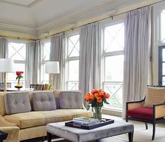 Windows that stretch from the floor to just below the ceiling fill this large, formal room with light. The operable windows, accented with X-shape grillwork, form columns of light. Keeping all of the windows the same style--rather than making one larger or arched--makes the room feel more unified./