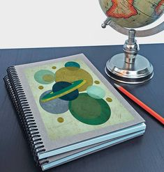Artist Shanni Welsh's Mid-century Planet writing sketchbook. Journal. Spiral notebook. Retro space and stars print. Cute gift for artist or writer. Customizable.