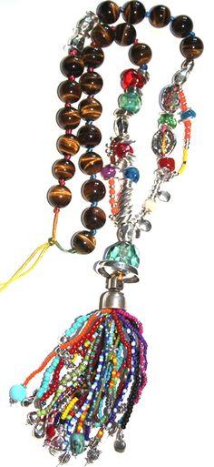 "#Collar ""ojito de tigre"" http://nellass.com/products/ojito-de-tigre%2C-largo.html #handmade #hechoamano Esta realizado en hilo de algodón, rocalla, zamak, cristal, resina,piedras semi preciosas, etc."