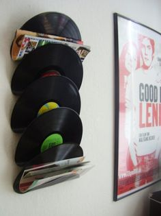 Magazine rack made from old vinyl records.  Baked in the oven at 225 degrees and molded to hold magazines.  Cute idea for a music room or man cave.