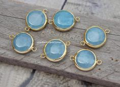 A personal favorite from my Etsy shop https://www.etsy.com/listing/214536444/light-blue-jade-bezel-connector-link
