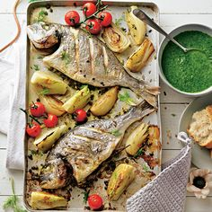 Dorade vom Blech mit Salsa verde Enjoy these top-rated grilled fish recipes outdoors this summer. Recipes include gingered honey salmon, tilapia piccata and even grilled fish tacos. Grilled Fish Tacos, Grilled Fish Recipes, Seafood Recipes, Salsa Verde, Salmon Croquettes, Fish Varieties, Baked Tilapia, How To Cook Fish, Fish And Seafood