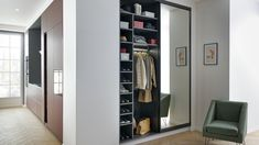 This sober and elegant entrance coat closet is equipped with a full height sliding mirror door and is guarantee to surprise you with its interior colours (Sirra red), practical wardrobe areas and shoe storage. Living Room Storage, Storage Spaces, Schmidt, Placard Design, Made To Measure Wardrobes, Dressing Area, Dressing Rooms, Sliding Panels, Wardrobe Design