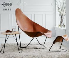What happens when you make half a Butterfly Chair? You get our modern leather armchair. And also extremely comfortable. Modern Lounge, Modern Chairs, Formal Living Rooms, Home Living Room, Living Room Inspiration, Interior Design Inspiration, Chair Design, Furniture Design, Leather Butterfly Chair