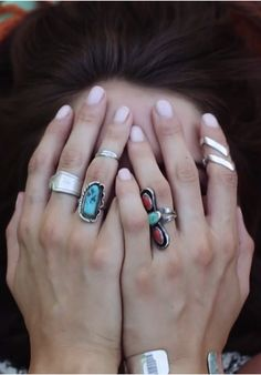 eclectic mix of southwestern silver rings #turquoise #spoonring #stones // pale pink mani #nails #styling #festival