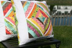 Flea market fancy and white, love this.  First pillows I fav'd in Flickr when I started sewing again 3 years ago.  Must make something similar soon!