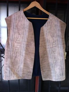 This is a Men's Reversible Jerkin. It is a perfect item for a Men's Renaissance Faire outfit. It is made of a Cream cotton blend on one side and 100% Navy Blue cotton on the other.