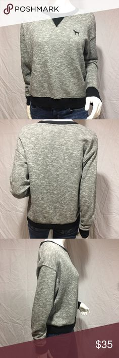 """PINK sweater Marled grey sweater with black outline around neckline, bottom of sweater, and bottom of sleeves. Also has a small black dog on the left side of the chest. Slightly oversized fit. Length:22"""", shoulder to shoulder: 19"""", waist 21"""" across. In great condition. Feel free to make me a reasonable offer 💕 PINK Victoria's Secret Sweaters Crew & Scoop Necks"""