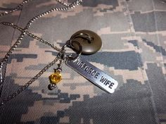 Military wife deployment necklace...  My friend at Carly's Homefront make's these!!  {http://www.facebook.com/#!/pages/Carlys-Homefront/152738741457628}
