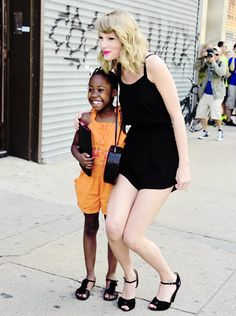 Taylor Swift and her little companie