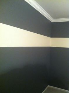 This bedroom has been transformed from plain white walls to creating a warm and sophisticated space. The walls were painted in a grey/blue color with a white horizontal painted 3/4 of the way up the wall. This horizontal stripe is a great way to have the eye travel in the space. They are also good for those small spaces helping to open them up just a bit and bringing energy into a space. The room turned out great and the homeowners love it.