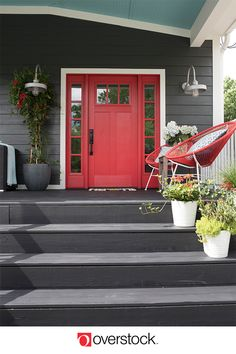 Brick House Exterior Discover The front porch at HGTV Urban Oasis 2018 WOWS guests with a bright red door and a welcome mat that packs a punch! Door Paint Colors, Exterior Paint Colors For House, Front Door Colors, Paint Colors For Home, House Paint Design, Red Door House, House Front Door, House With Porch, Front Porch